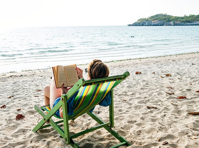 woman-reading-a-book-on-the-beach-